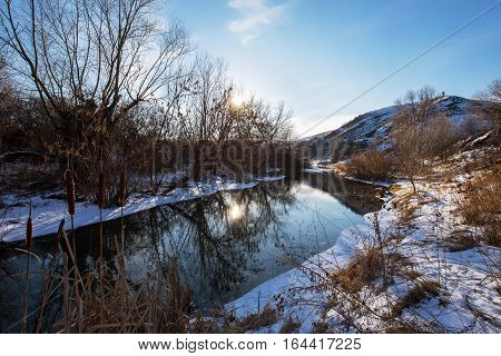 Winter river landscape at bright sunny day.
