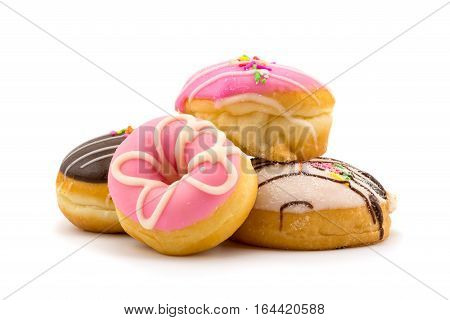 Pile of colorful tasty doughnuts on white background