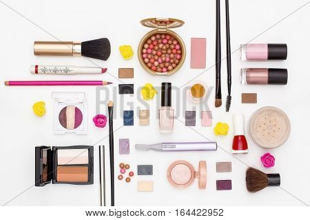 makeup cosmetics brush nail Polish powder trimmer and other accessories on white background top view. beauty flat lay concept