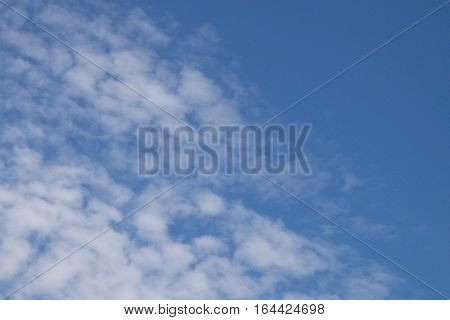 Close-up to altocumulus cloud on morning background
