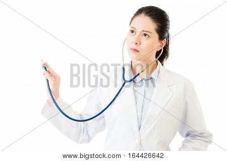 Successful Asian Woman Doctor Use Stethoscope To Auscultation