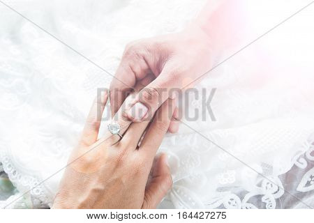 love couple relationship and holidays concept - close up of man giving diamond ring to woman