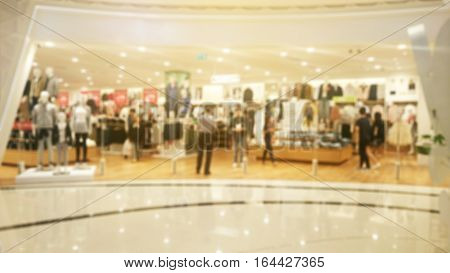 Blurred image of people in shopping mall.