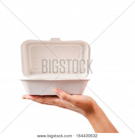 natural plant fiber food box in hand isolated on white background. Saved clipping path.