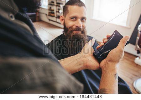 Barber Serving Client At His Shop