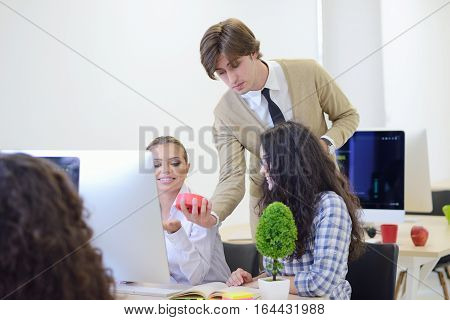 young angry businessman pointing his watch as concept of arrive late at the work at modern startup office