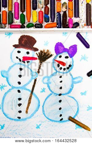 Colorful drawing with crayons of a happy snowman couple