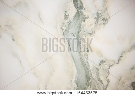 Lightened slices marble onyx. Horizontal image. Warm green colors. Beautiful close up background. Ideal for sites, banners, brochures, design