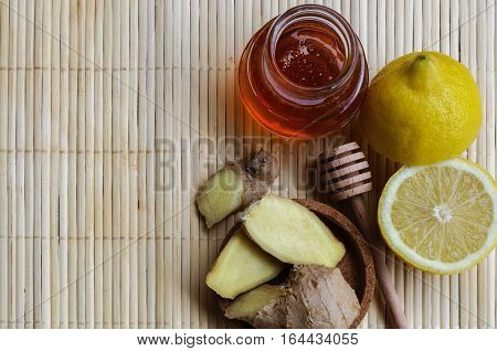 Ginger with lemonspice and honey. Alternative treatment for cold or flu symptoms. Traditional medicine and natural health care concept. Copy space.