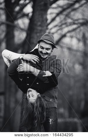 Dad holding his daughter upside down on his hands