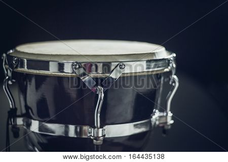 Goblet drum or darbuka, percussion musical instrument on dark background