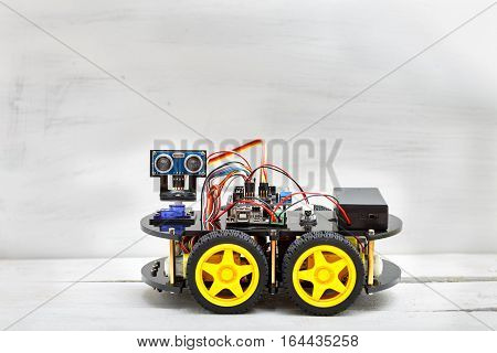 robot on four wheels and the various conductors