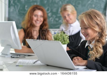 Portrait of a teacher with two girls at lesson