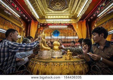 INLE-LAKE, MYANMAR - OCT 06 2014: The peoples make merit in Phaung Daw Oo Pagoda at Inle Lake in October 2014.
