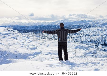 Young Skier, Enjoying The View From Top Of Mountains In Austrian Ski Resort On A Sunny Winter Day
