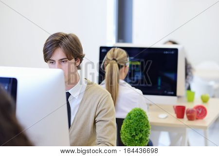 startup business, software developer working on computer at modern office.