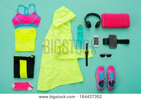 Sports Clothing And Accessories On Turquoise Background.