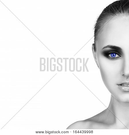 Half face of beautiful woman with bright makeup isolated on white background