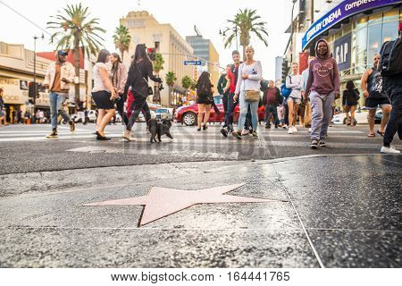HOLLYWOOD CA - OCTOBER 12 2016. Views of the Walk of Fame and the Buildings at the Hollywood Boulevard. This street is an icon for the Movie industry in Hollywood.