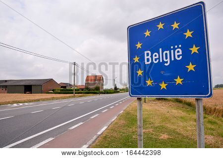 Road Sign Indicating The Border Of Belgium