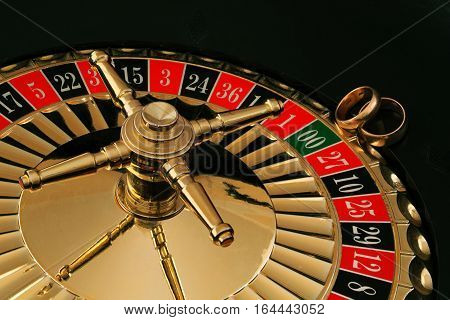 two wedding rings on the roulette wheel