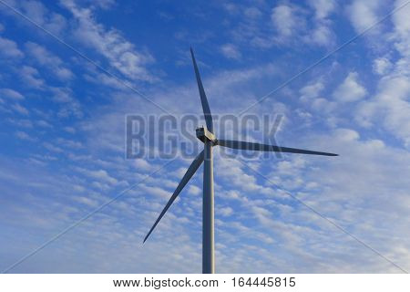 It is a shiny day in winter and this is a wind turbine in Oberwichterich.