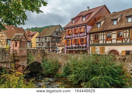 View of Kaysersberg with old stone bridge Alsace France