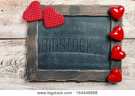 Happy Valentine's Day Love Chalkboard for restaurant menu board with wooden frame and hearts with copy space