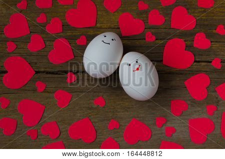 Unusual two eggs in love with the muzzle and red hearts