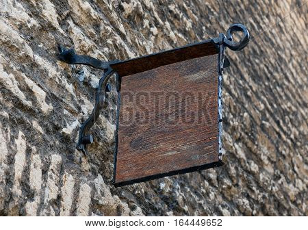 Empty wooden medieval style outdoor signage mockup to add company logo