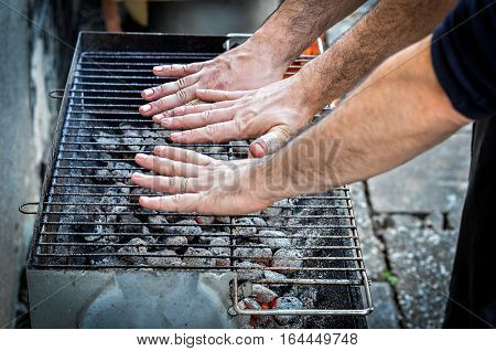 Hands Are Testing The Barbecue Heat On Charcoal Briquettes Bbq.