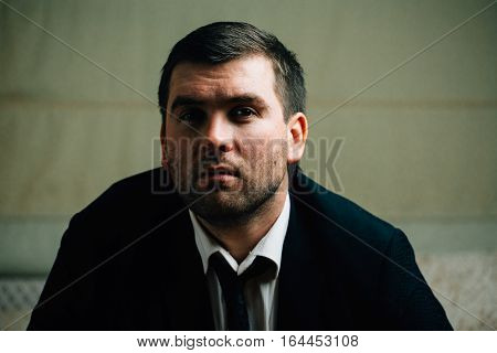 Serious angry young businessman close up portrait