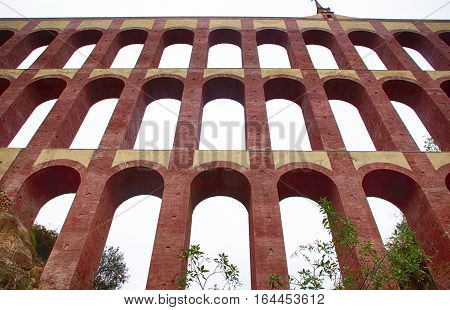 Aqueduct Puente del Aguila or Eagle Bridge in Nerja Malaga Spain. Low angle view