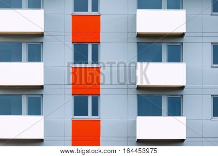 Windows and balconies of new residential building as natural geometrical background