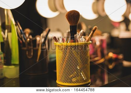 Make up table with professional makeup brush.Visagiste tools.Different brushes for cosmetics.