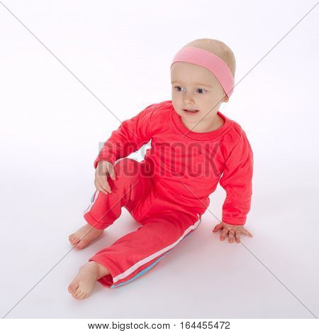 cute little girl doing exercice on white background