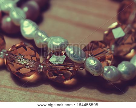 glass beads close up in wooden background