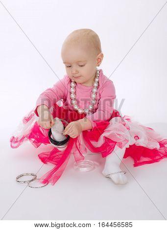 little funny girl wearing bracelet on feet