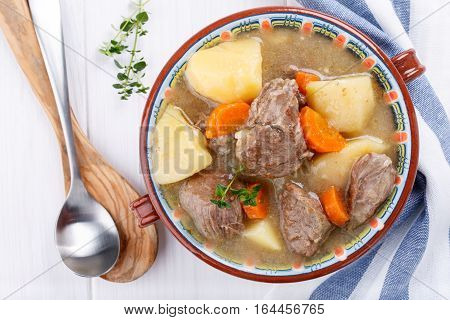 Meat stew with potatoes and carrots. Goulash soup. Top view.