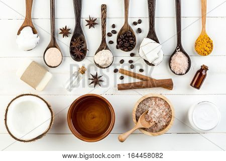 Homemade Coconut Products On White Wooden Table Background. Oil, Scrub, Soap, Milk, Lotion, Himalaya