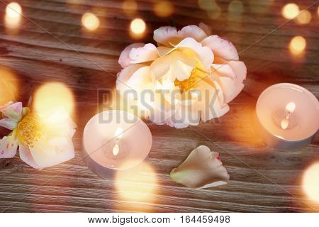 Romantic Spa decoration on wood with candle and bokeh for a little time out