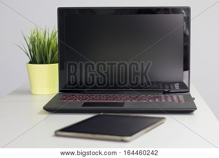 Laptop tablet - everyday electronic devices for office work.