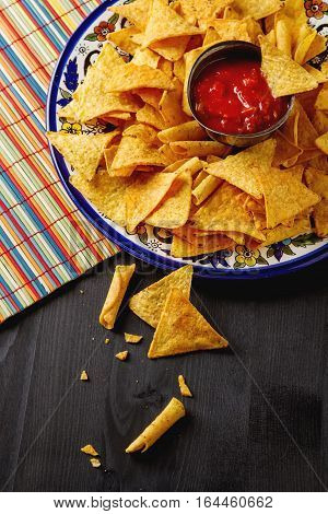 Tortilla Chips On A Blue Plate With Spicy Tomato Salsa. Mexican