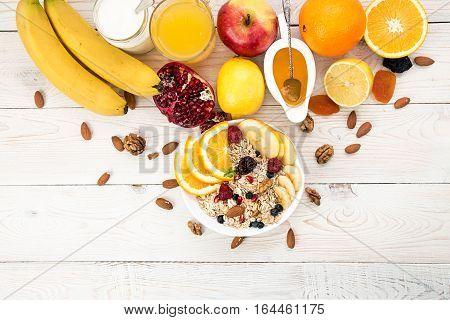 Healthy Breakfast. Muesli, Yogurt, Honey And Fruits On White Table.