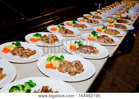 Barbecue pork ribs and vegetables on white plate