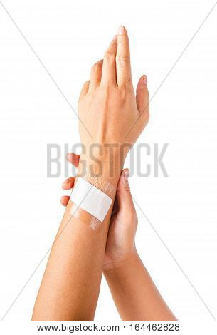 Adhesive bandage with transparent waterproof on hand woman. Isolated on white background. Saved clipping path.