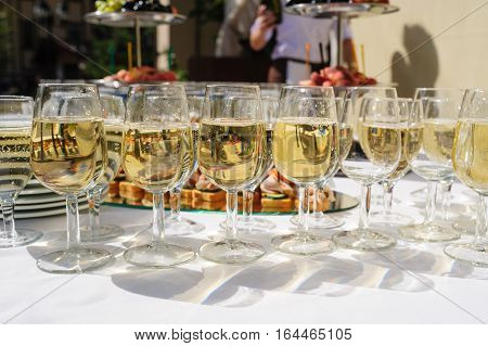 glasses with champagne at the wedding ceremony on table