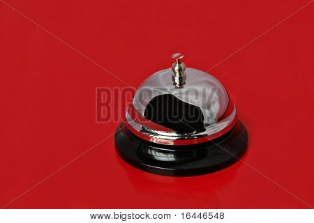 A service bell isolated on a bright red background