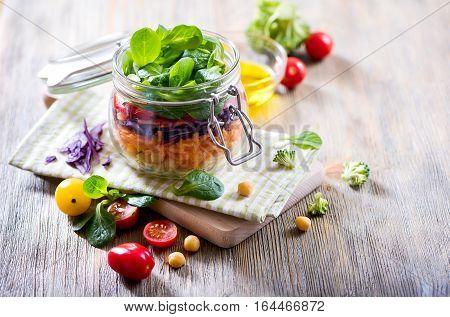 Healthy homemade chickpea and veggies salad in jar diet vegetarian vegan food vitamin snack
