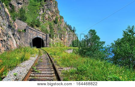 Old tunnel under highest mountain. Circum-Baikal Railway. Irkutsk region. Russia